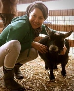 Photo of Melissa Huggins at a farm sanctuary.