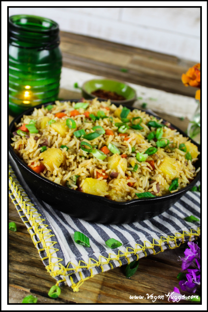 Side view of Easy Pineapple Fried Rice in a cast iron skillet.