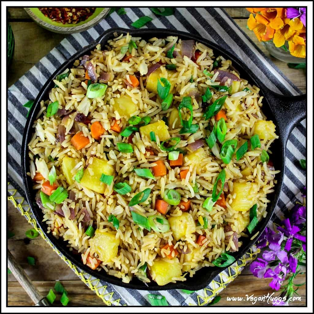 This Easy Pineapple Fried Rice is sweet, savory & tangy. It's a healthier alternative to takeout, because it's lower in sodium, vegan & gluten-free.