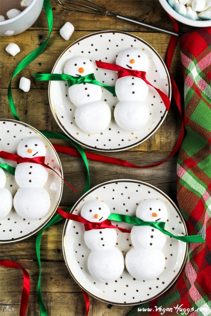 These snowman-shaped vegan meringue cookies will be a hit at your next wintertime gathering. They are sweet, crisp, airy and completely adorable!