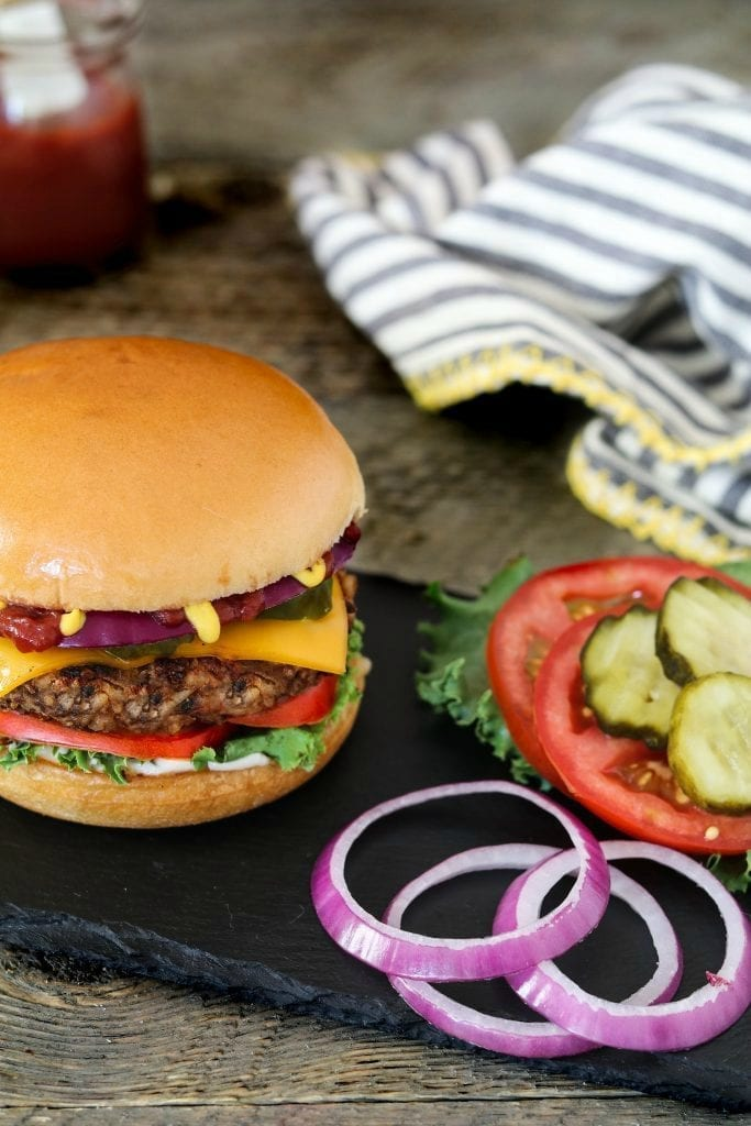 This Ultimate Bean & Mushroom Burger passes the test! It won't fall apart and it's hearty, satisfying, smoky & bursting with rich umami flavor! Vegan & gluten-free.