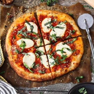 Try out this restaurant-style Vegan Pizza Recipe in the comfort of your own home. It's easy to make and delivers the most delicious crust.