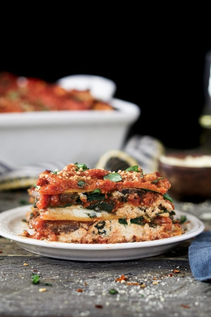 "The epitome of comfort food, this Vegan Spinach Mushroom Lasagna has 4 dreamy layers of savory marinara, creamy ""ricotta"", ribboned noodles & sautéed veggies."