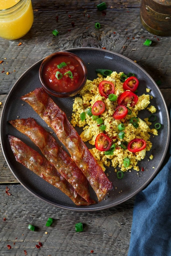 Rice Paper Vegan Bacon with tofu scramble on a grey plate