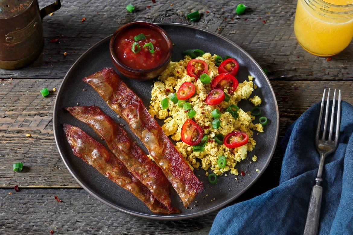 Horizontal photo of rice paper vegan bacon and tofu scramble on a plate