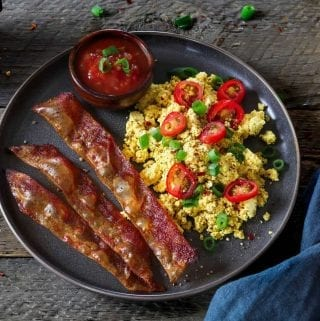 Horizontal photo of rice paper vegan bacon and tofu scramble on a plate