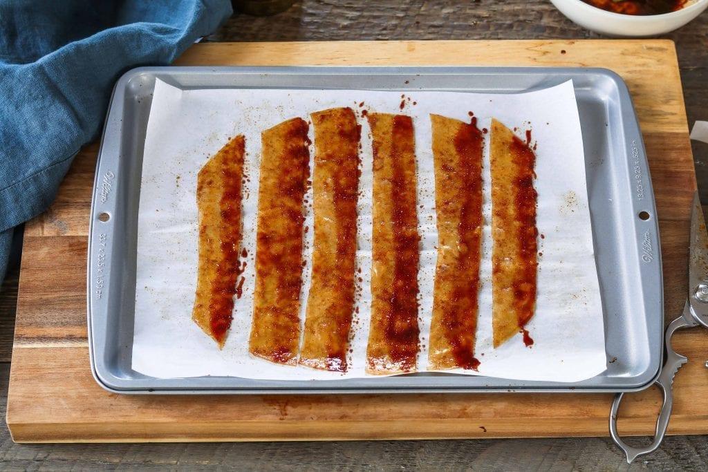 Prepared rice paper strips on baking sheet.