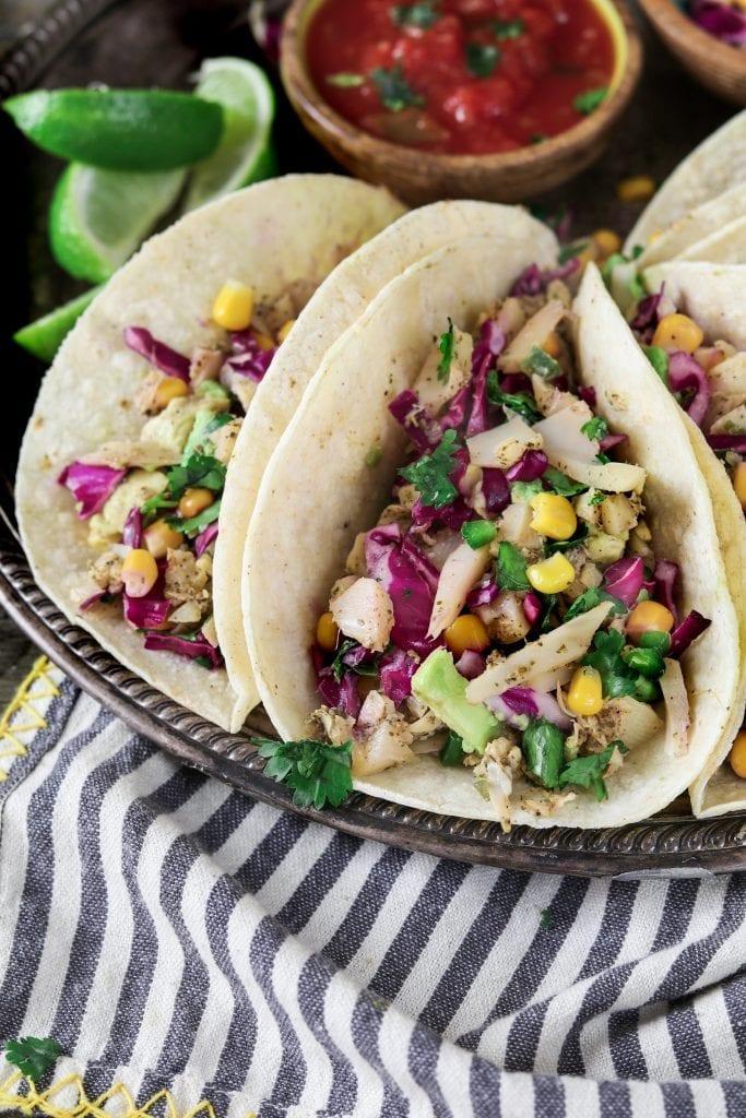 Closeup photo of two vegan fish tacos.