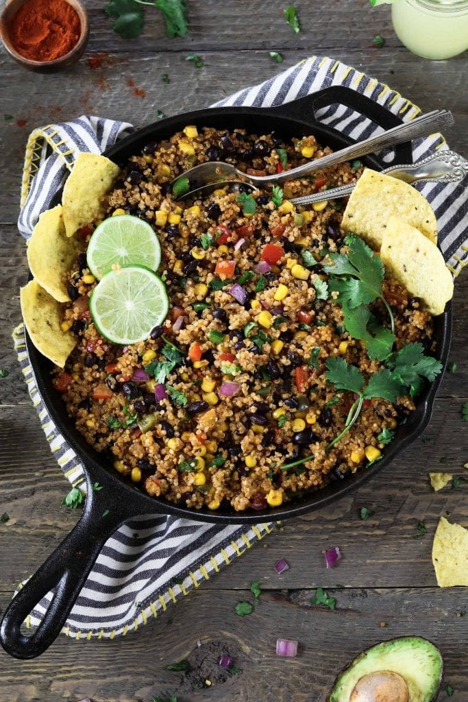 Cast iron skillet filled with fully cooked One Pan Mexican Quinoa.