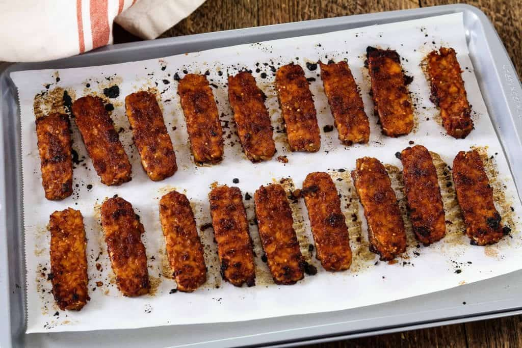 Fully baked tempeh on a baking pan.
