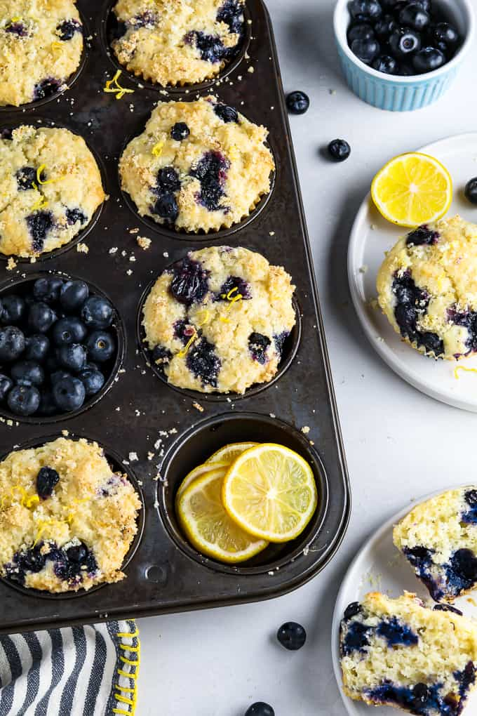 Overhead view of baked lemon blueberry muffins in a muffin pan.