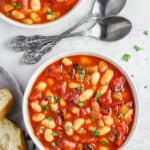 overhead view of two bowls of tomato white bean soup