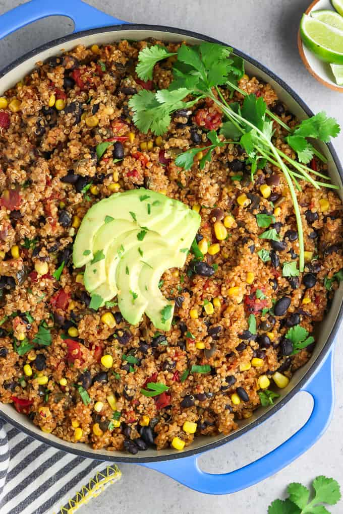 Overhead view of one pan Mexican quinoa topped with avocado slices and cilantro.