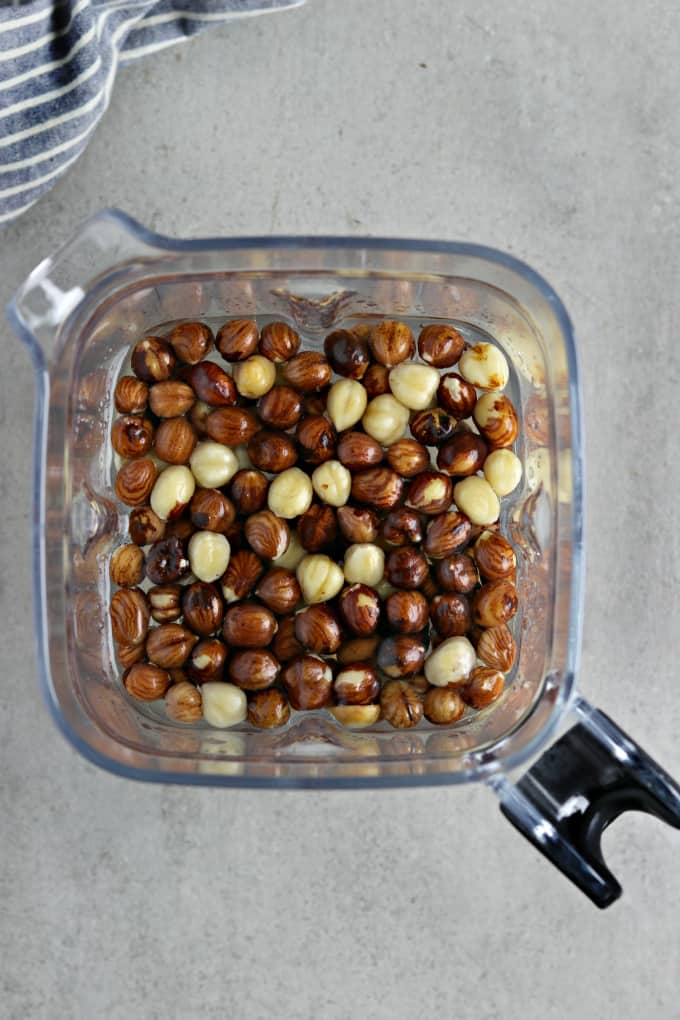 Whole hazelnuts and water in a blender.