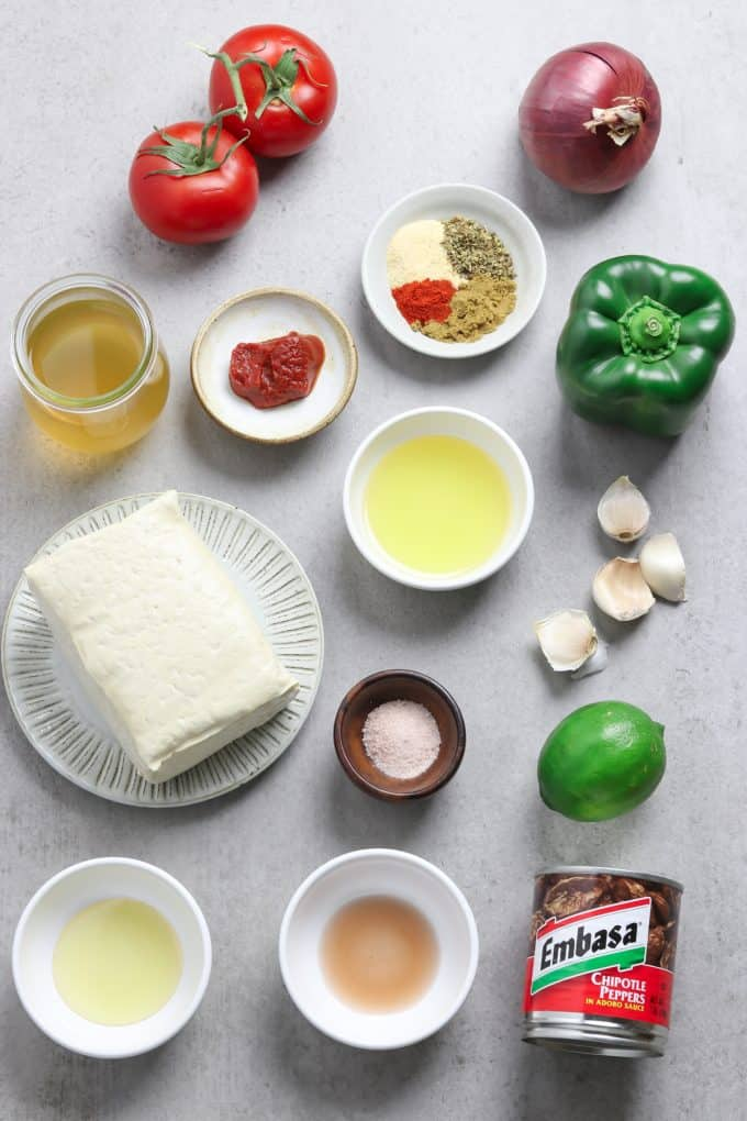 Ingredients for the recipes spread out on a stone table top.