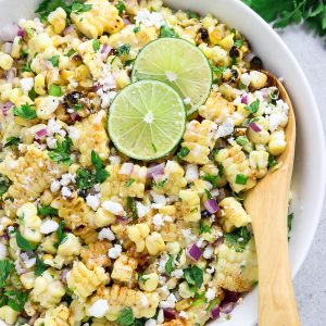closeup view of corn salad in a white bowl