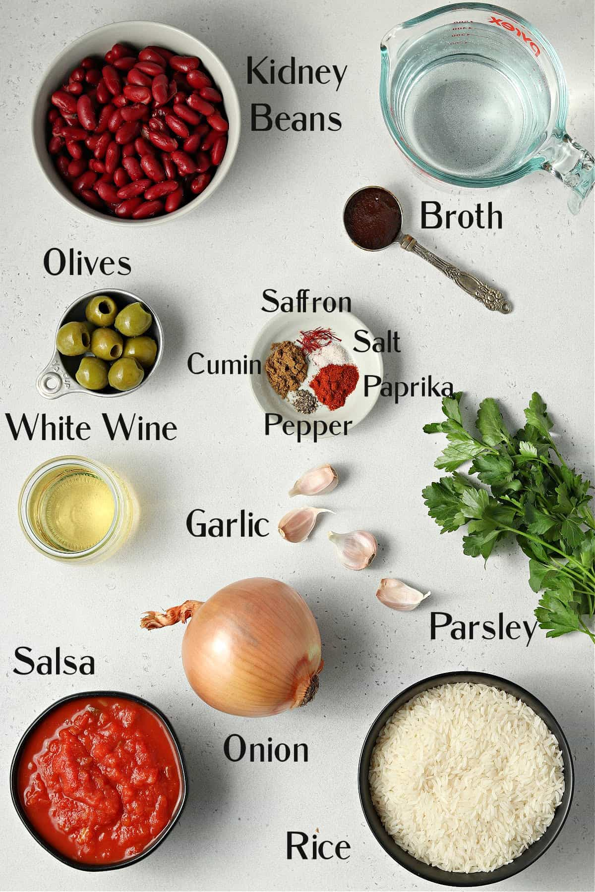 All ingredients to make the rice on a stone table top.