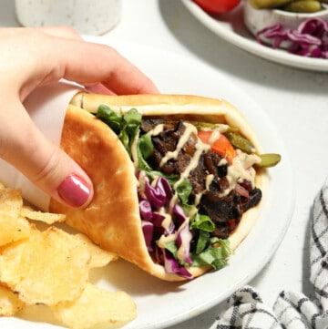 folded shawarma on a white plate