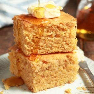 Two pieces of cornbread stacked together.